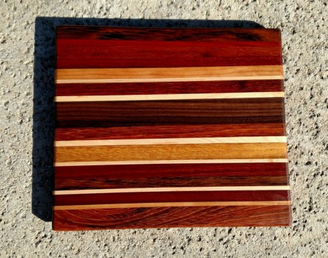 "Cheese Board 17 - 319. Jatoba, Honey Locust, Bloodwood, Jatoba, Hard Maple, Teak & Padauk. Chaos Board. 11"" x 9-1/2"" x 5/8""."
