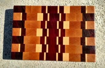 "Cutting Board 17 - 414. Padauk, Cherry, Hard Maple, Bloodwood, Purpleheart, Black Walnut & Jatoba. End Grain. 9-1/2"" x 14"" x 1"". Sold before it was finished."