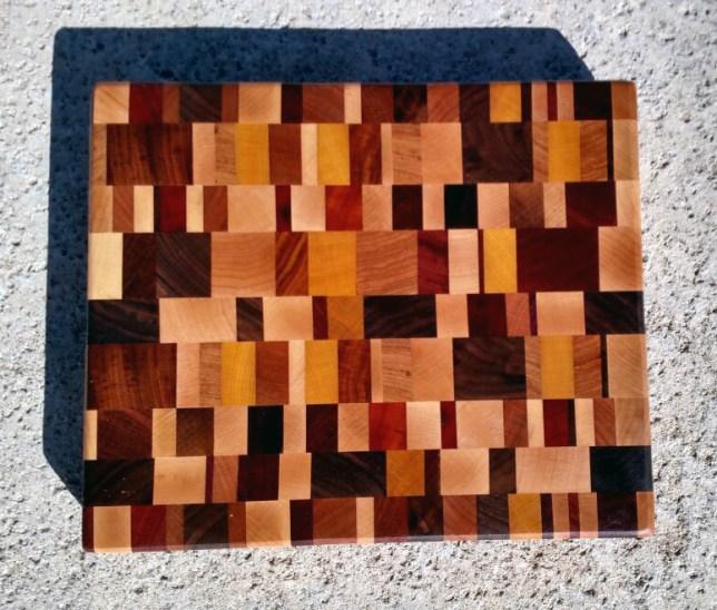 "Cutting Board 17 - 415. Oak, Hickory, Hard Maple, Jatoba, Padauk, Bloodwood, Canarywood, Goncalo Alves, Yellowheart & Black Walnut. End Grain. Chaos Board. 11"" x 13"" x 1-1/4""."