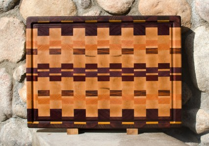 "Cutting Board 17 - 426. Black Walnut, Bubinga, Purpleheart, Yellowheart, Hard Maple, Honey Locust, Goncalo Alves & Padauk. End Grain, Juice Groove. 16"" x 21-1/2"" x 1-1/2""."