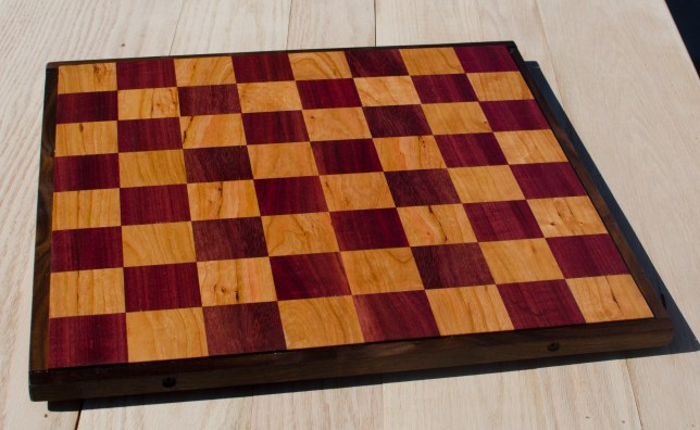 "Chess 17 - 302. Purpleheart & Cherry, proud of the Black Walnut frame. 18"" x 18"" x 1""."