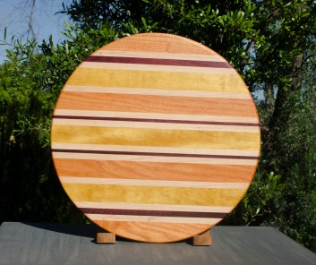 "Lazy Susan 17 - 05. Honey Locust, Hard Maple, Purpleheart & Yellowheart. 18"" diameter."