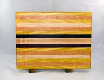 "Cutting Board 17 - 123. Yellowheart, Honey Locust, Hard Maple & Purpleheart. Edge Grain. 12"" x 16"" x 1-1/8""."