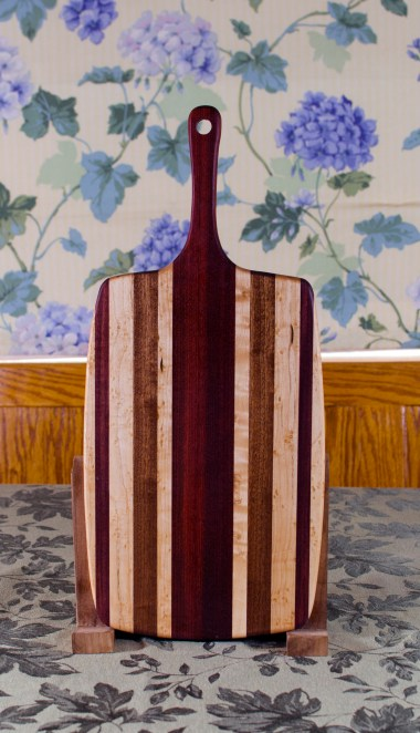 "Sous Chef 17 - 914. Birdseye Maple, Jatoba, Purpleheart & Bloodwood. Large size, with the work space approximately 10"" x 15"", with the handle extending for an additional 6""."