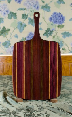 "Sous Chef 17 - 915. Purpleheart, Cherry, Bubinga, Black Walnut & Bloodwood. Large size, with the work space approximately 11"" x 15"", with the handle extending for an additional 6""."