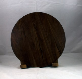 "Serving Piece 17 - 802. Black Walnut. 14"" diameter, 1-1/8"" thick. Urethane finish."
