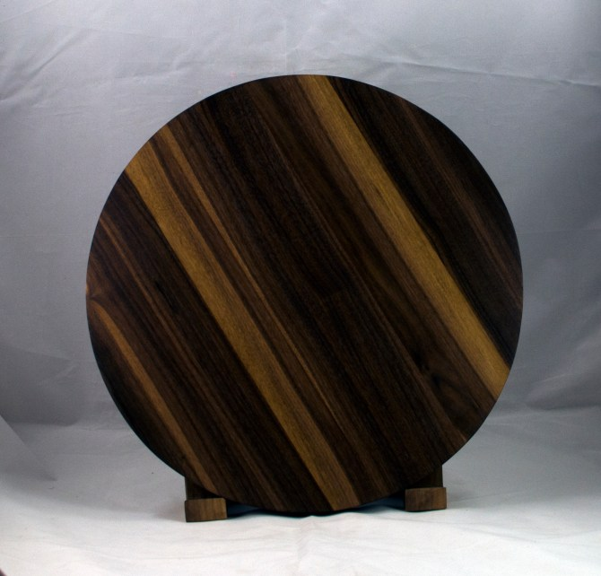 "Serving Piece 17 - 803. Black Walnut. 16"" diameter, 1-1/8"" thick."