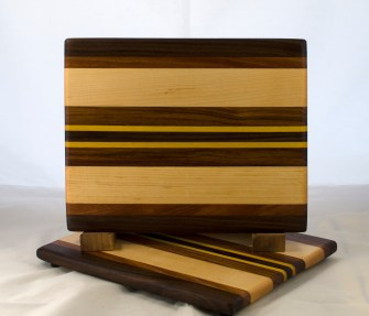 "Cheese Board 17 - 331. Black Walnut, Canarywood, Hard Maple and Yellowheart. 8"" x 11"" x 5/8""."