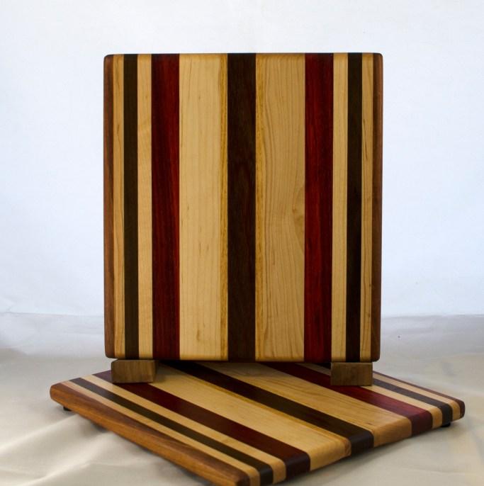 "Cheese Board 17 - 337. Canarywood, Yellowheart, Hard Maple, Padauk & Black Walnut. 8"" x 11"" x 5/8""."