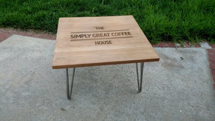 The coffee table has stainless steel legs.