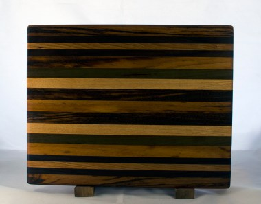 "Cutting Board 17 - 130. Goncalo Alves, Cherry, Black Walnut & Honey Locust. Edge grain. 12"" x 16"" x 1-1/4""."
