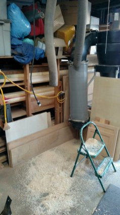 I moved tools around to make room for the CNC, and the dust collection hoses needed to move as well. I started to do that ... and they dumped the sawdust in the pipes. Thank goodness the floor was clear; it was easier to sweep. And sweep again.