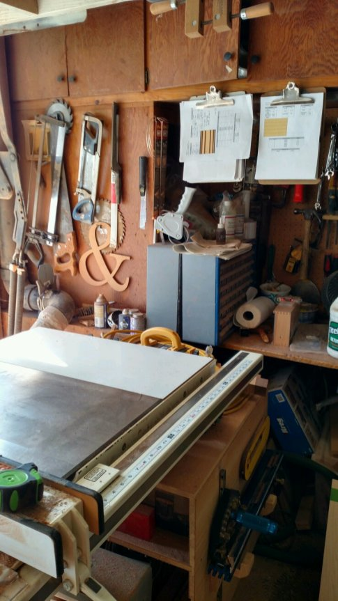 The table saw sits in the garage door, next to the original workbench. This works fine ... until I have to cut lumber longer than 8'.