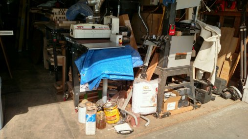 The end of the tool line, with the finishing supplies on the ground, left over from my last 2 large special projects. That's gotta go.