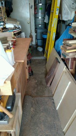 The back side of the workbench is a path, thankfully ... with plywood and lumber storage cluttering the way. Not. Good.