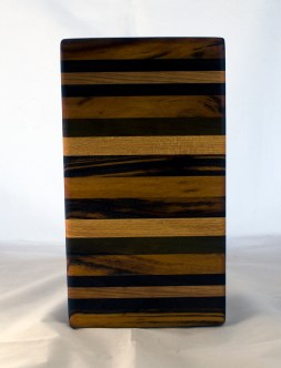 "Small Board 17 - 233. Goncalo Alves, Cherry, Black Walnut & Honey Locust. 7"" x 12"" x 1-1/4""."
