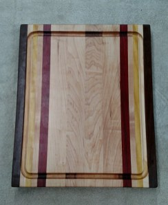 "Cutting Board 17 - 133. Jatoba, Hard Maple, Yellowheart & Purpleheart. Edge grain, Juice groove. 12"" x 16"" x 1-1/8""."