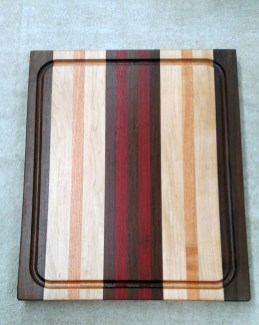 "Cutting Board 17 - 134. Jatoba, Hard Maple, Honey Locust & Padauk. Edge grain, Juice groove. 14"" x 18"" x 1-1/8""."