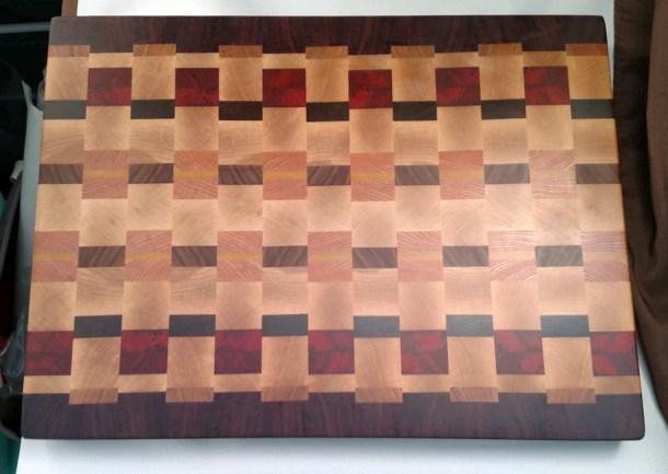 "Cutting Board 17 - 438. Purpleheart, Cherry, Hard Maple, Padauk, Jatoba, Honey Locust, Pau Ferro & Yellowheart. End Grain. 16-1/2"" x 21-1/2"" x 1-1/2"". Sold in its first showing."