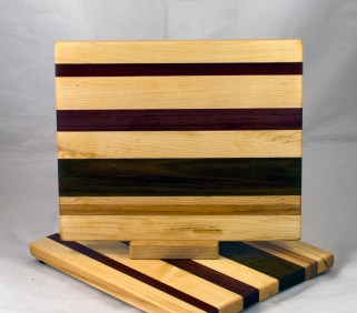 "Cheese Board 17 - 347. Hard Maple, Padauk, Black Walnut & Canarywood. 9"" x 11"" x 3/4""."