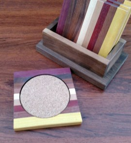 Coasters 18 - 06. Chaos Coasters. Yellowheart, Jatoba, Bloodwood, Cherry, Hard Maple, Jatoba, Purpleheart & Cork. Shown with Black Walnut holder.