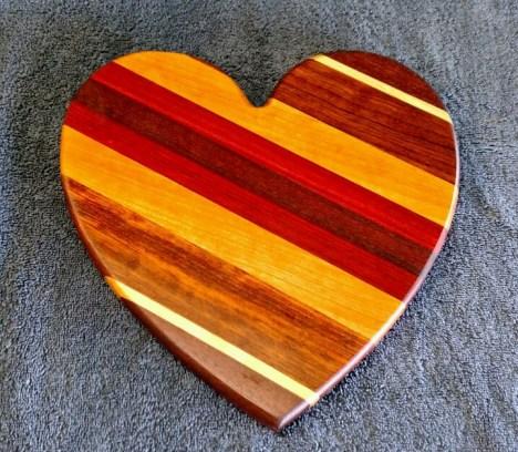 "Heart 18 - 907. Black Walnut, Hard Maple, Jatoba, Cherry, Bloodwood & Purpleheart. Sold in its first showing. 11"" x 11"" x 3/4""."