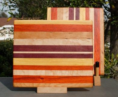"Cheese Board 18 - 105. Chaos Board. Yellowheart, Padauk, Cherry, Birds Eye Maple & Purpleheart. 8"" x 11"" x 5/8""."