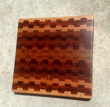 "Cutting Board 18 - 719. 15"" x 15"" x 1-1/4"". Hard Maple, Goncalo Alves, Cherry, Jatoba, Sapele, Purpleheart & Canrywood. End grain."