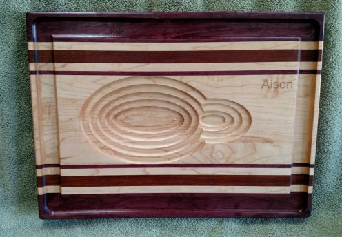 "Carnivore Board 18 - 901. Purpleheart, Jatoba & Hard Maple. 14"" x 19"" x 1-1/8"". Custom Order."