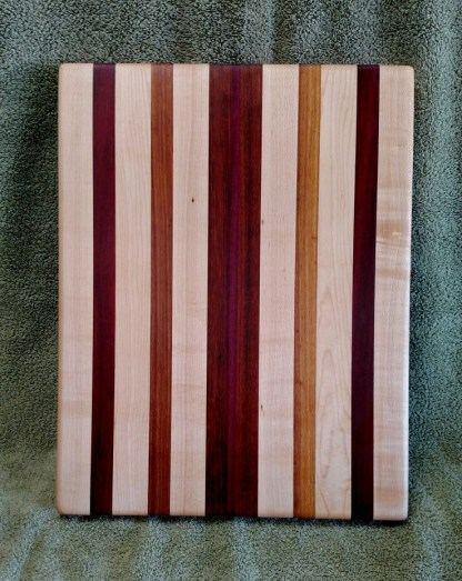 "Cutting Board 18 - 321. Hard Maple, Bloodwood, Canarywood & Purpleheart. 12"" x 16"" x 1-1/18""."