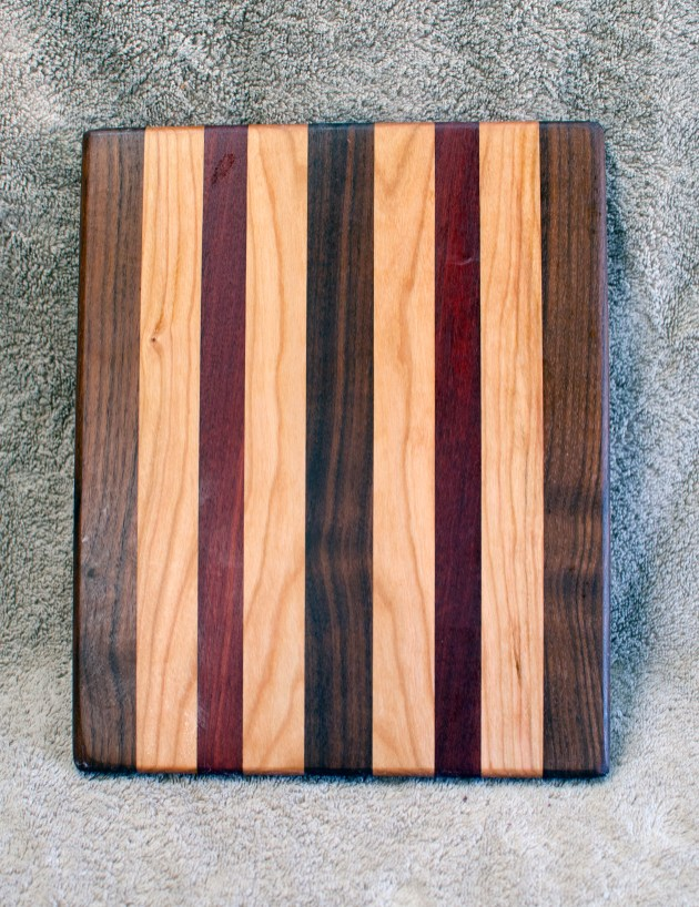 "Cheese Board 18 - 123. Black Walnut, Bloodwood & Cherry. 8"" x 11"" x 5/8""."