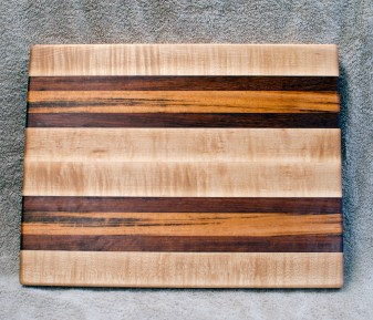 "Cutting Board 18 - 325. 12"" x 16"" x 1-1/4"". Hard Maple, Jatoba & Goncalo Alves. Edge Grain."
