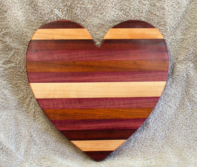 "Heart 18 - 928. Jatoba, Hard Maple, Purpleheart & Bloodwood. 11"" x 11"" x 3/4""."