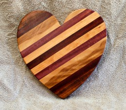 "Heart 18 - 930. Jatoba, Hard Maple, Purpleheart & Bloodwood. 11"" x 11"" x 3/4""."