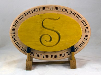 Cribbage 18 - 28. Yellowheart top for a 3 track board.