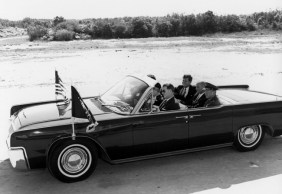 Riding with the President at Cape Canaveral. JFK gave Glenn the Distinguished Service Medal.