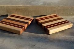 "# 57 Cutting Board, $60 each. Edge grain. 11"" x 11"" x 1-1/2"". Hard Maple, Padauk, Yellowheart & Walnut."
