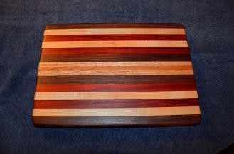 "# 22 Cutting Board, $60. Edge grain. Walnut, maple, padauk, oak, and cherry. 16"" x 12"" x 1-1/4""."
