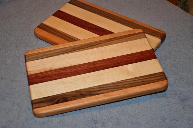 "Cheese Board 15 - 008. Cherry, Black Walnut, Hard Maple and Jarrah. 8"" x 12"" x 3/4""."