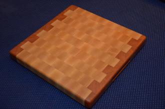 "Cutting Board 15 - 042. Cherry and Hard Maple end grain. 12"" x 12"" x 1-3/8"". Side routed handles; no feet so it's a 2-sided board. Commissioned piece."