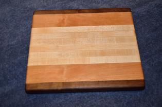 "Small Board # 15 - 031. Black Walnut, Cherry and Hard Maple. 9"" x 11"" x 1""."
