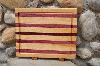 "Cutting Board # 15 - 053. Hard Maple & Purpleheart edge grain with juice groove. 14"" x 18"" x 1-1/2"". This board sold the first time a customer saw it."
