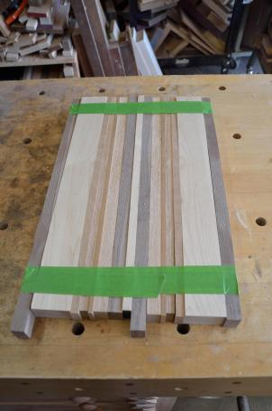 The boards get taped up after the pieces are selected ... to make them easy to move around the shop prior to gluing.