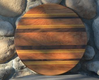"""Lazy Susan 15 - 013. Hard Maple, Yellowheart, Teak and Black Walnut. Lovely grain on this one - this dark brown Hard Maple came from a single plank, and the grain is matched across the piece. 17"""" diameter."""