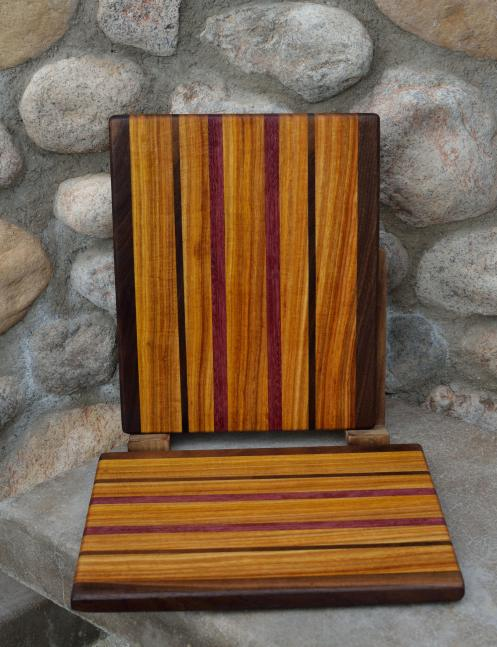 "Cheese Board # 15 - 027. Black Walnut, Canarywood and Purpleheart. Edge Grain. 8"" x 11"" x 3/4""."