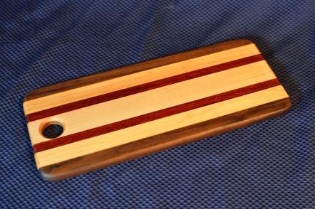 """Bread Board # 11. Black Walnut, Hard Maple & Padauk. 5"""" x 15"""" x 3/4"""". Sold at its first showing."""