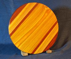 """Lazy Susan # 15 - 036. Jarrah & Canarywood. 17"""" diameter x 3/4"""". The colors are just about perfect in this photo: this piece is colorful!"""
