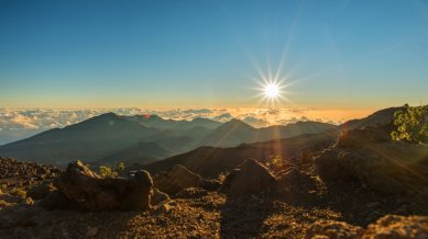 """Sunrise above the clouds and over Haleakala National Park. To see how I captured my own sunrise photos on top of this volcano, see """"The Haleakala Adventure"""" on this blog. This particular photo was tweeted by the US Department of the Interior, 11/12/15."""