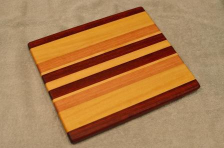 "Cheese Board # 15 - 068. Black Walnut, Yellowheart & Cherry. 9"" x 11"" x 3/4""."