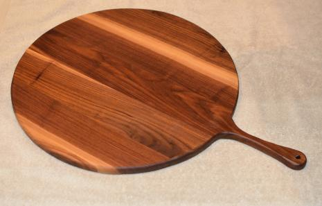 "Pizza Server # 15 - 03. Black Walnut. 17"" x 3/4"" with 7"" handle."